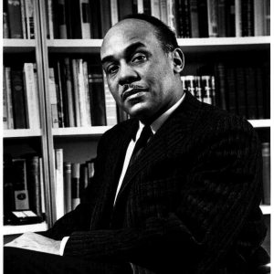 Black and white photo of Ralph Ellison seated